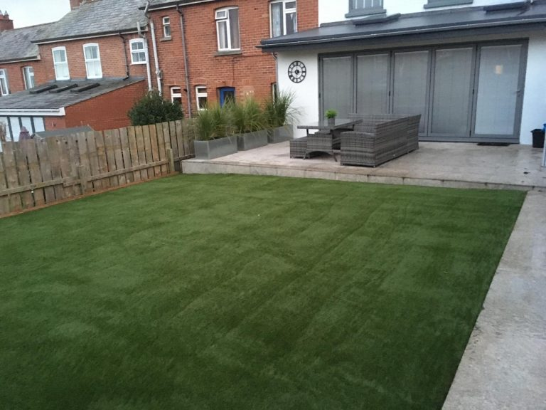 Artificial grass install outside bifold doors