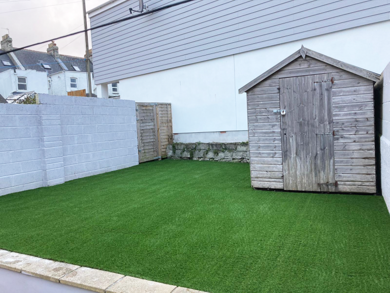 Artificial grass next to the shed